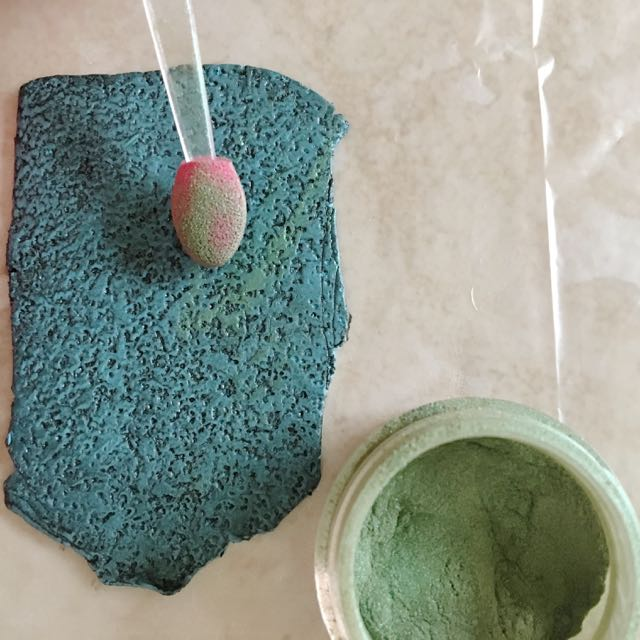 step 11 - With a soft sponge applicator or paint brush, brush green mica powder across the surface.