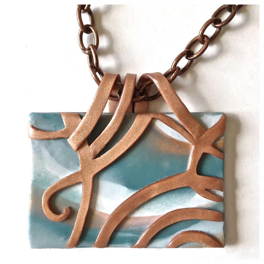 curio scrolled pendant.jpg