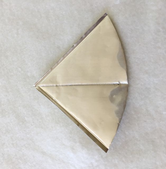 "step 11 - Place the foil on fleece or another soft cloth. With an embossing tool, score the centerline of the roof. Score a line 1/8"" from each straight edge and fold the edges at a 90-degree angle."