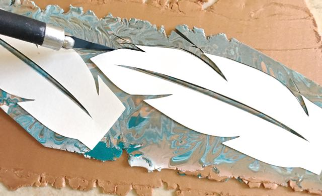 step 11 - Use a craft knife to cut out the feather shapes through both clay layers.