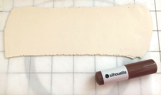 Step 3 -  SC   Cutting  - Place the clay on the shiny side of Freezer Paper and set it on the cutting mat. Use the grid to match the clay on the mat to the image in the design window. Remove the cap from the deep cut blade and set it to its maximum length.