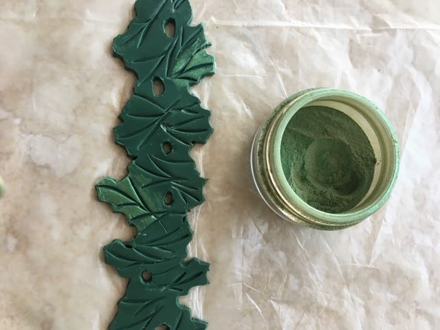 step 6 - With your finger, apply green Mica Powder to a few leaves. Continue adding Copper, Pearl, and Heirloom Gold powders.