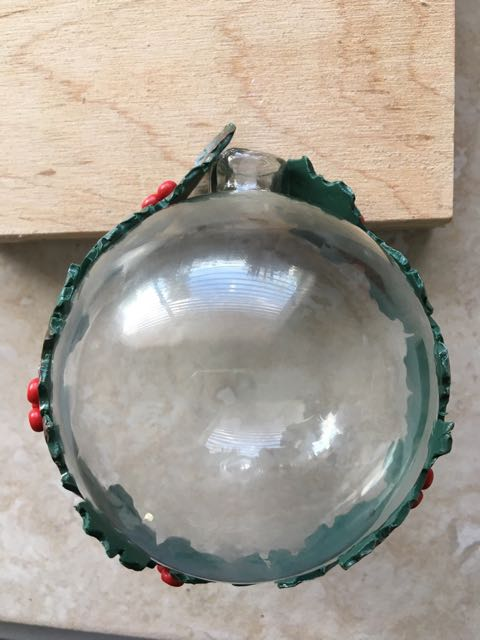 step 10 -When berries and powder have been added to all the clay strips, wrap the longest around the glass ornament