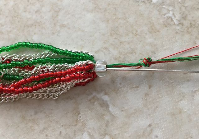 step 5 - Slip a nail head wire into the bead. Allow the glue to set.