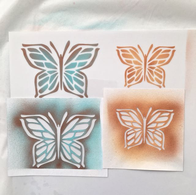 step 7 - Remove the stencils and move them down the sheet. Do not place the sticky card stock back on painted areas of previously painted butterflies. Create a total of seven or eight butterflies.