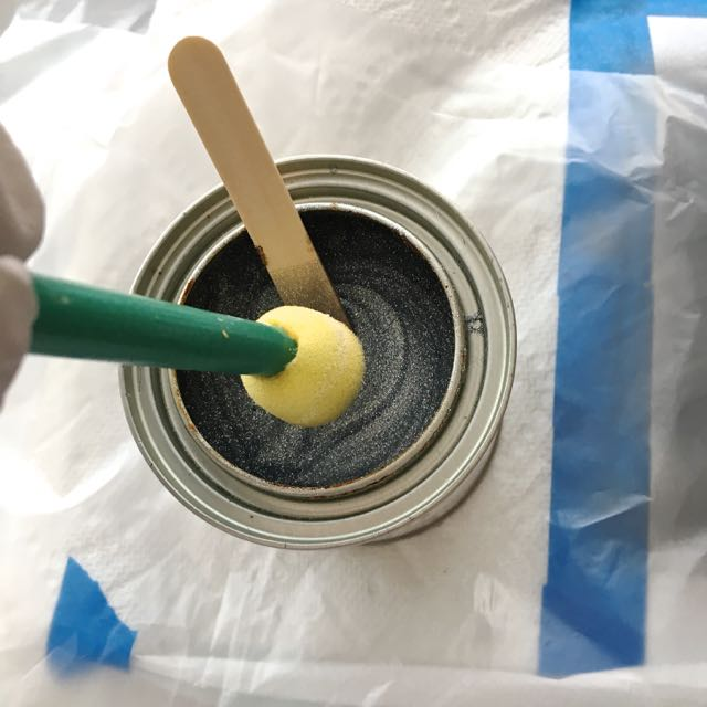 step 5 - Dip the flat surface of a sponge dauber into the paint. Wipe excess against the craft stick to avoid over-saturating the stencil.