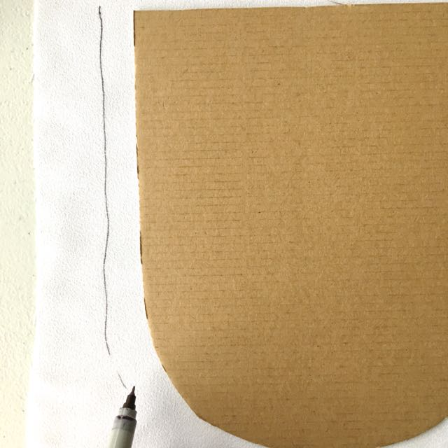 """step 13 -Trace the mailbox flap onto cardboard. Cut out the shape. Place the cardboard on the wrong side of white satin fabric and trace it about .50"""" away from the cardboard edge."""