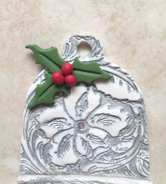 step 14 - Lightly press the berries to the leaves. If your embossed design has a center point, press on an appropriate size hot fix rhinestone.