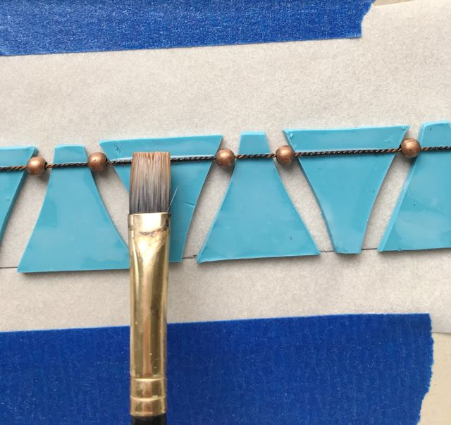step 16 - Apply Liquid Polymer Clay to the cord's surface.