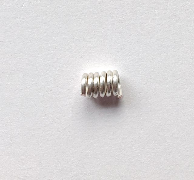 step 2 - Slip the wire off the needle. Trim the tails from the coil. You will need four identical coils.