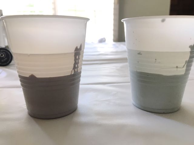step 2 - Pour your paint colors then water into transparent plastic cups and stir thoroughly. The water sits on top of the paint allowing you to see how much of each you are using. Add three or four drops of silicone lubricant to each color to create cells in the finished art.