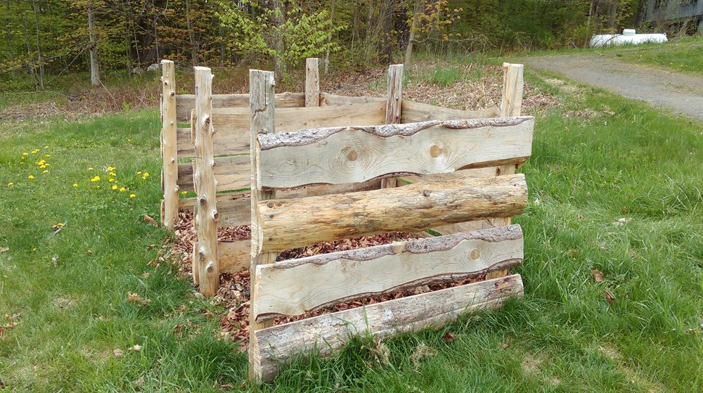 we built this compost bin out of boards we milled at our home in montague. it is similarly open to sun and rain, and the compost will cook fast!