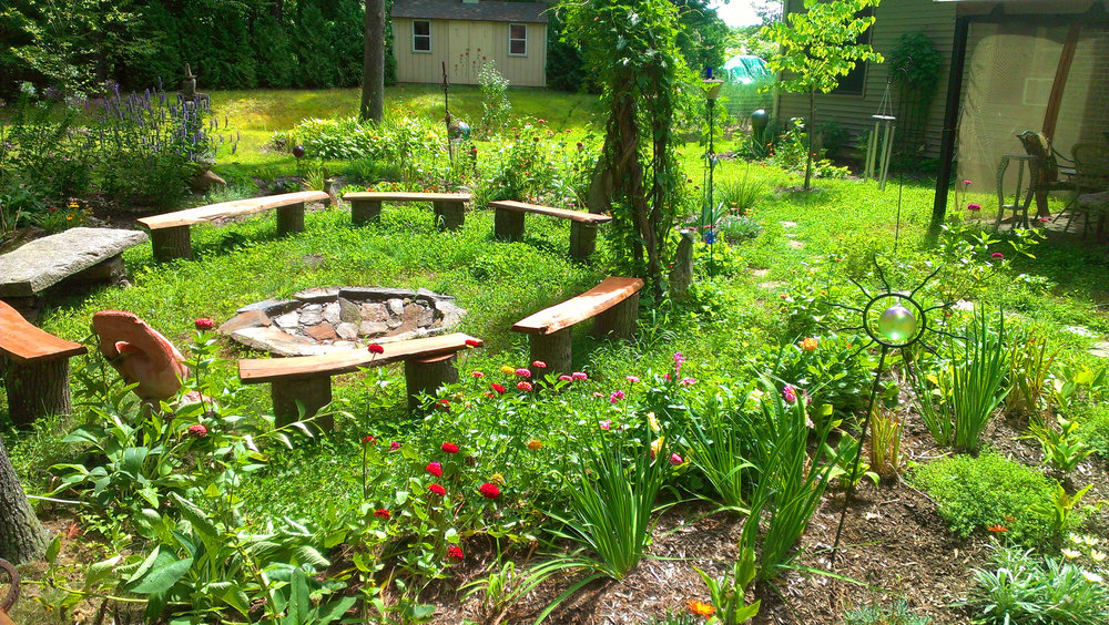 flower gardens built to encircle the firepit with beauty