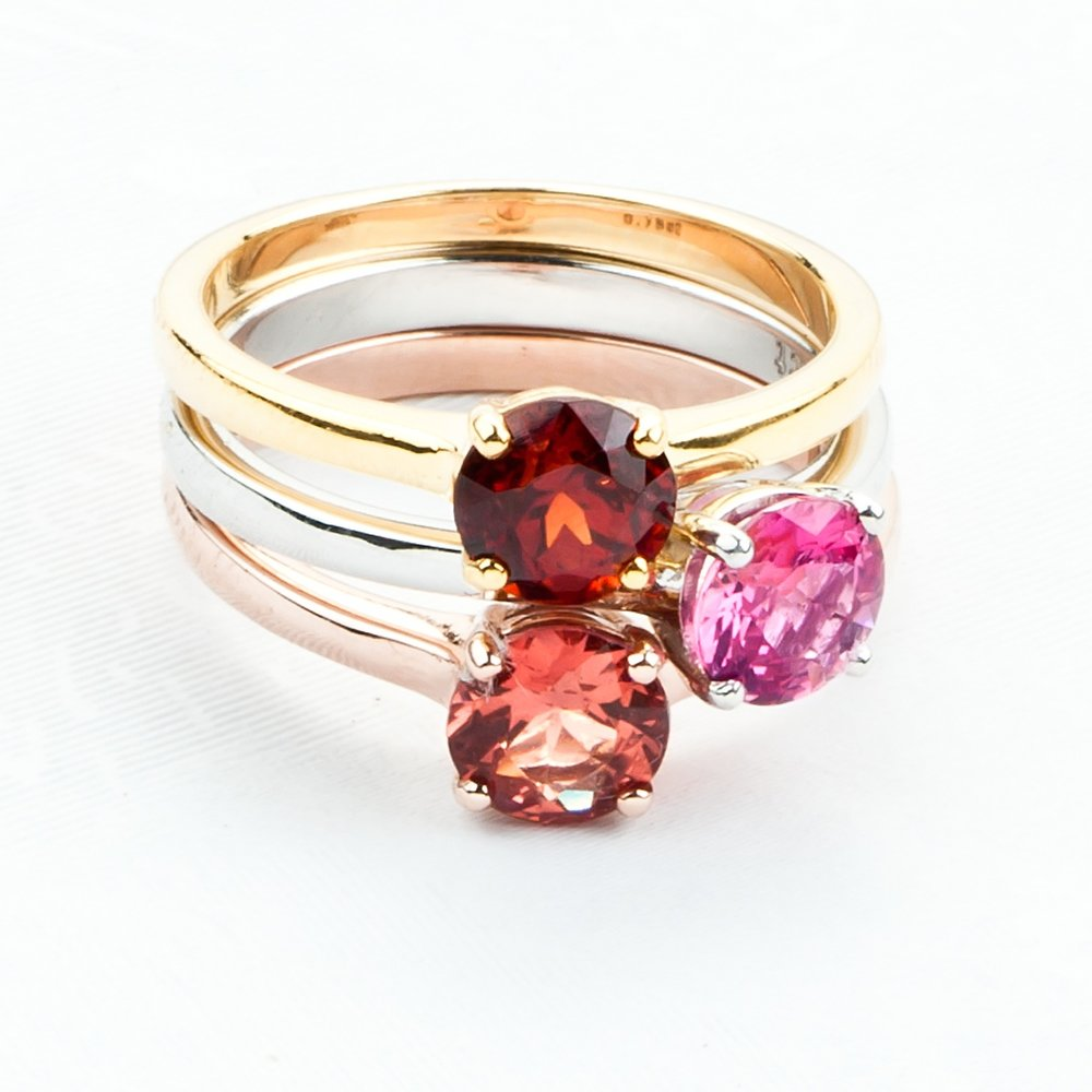 Delicate solitaire rings in juicy spinels . 9k white, yellow and pink gold. From USD $230.