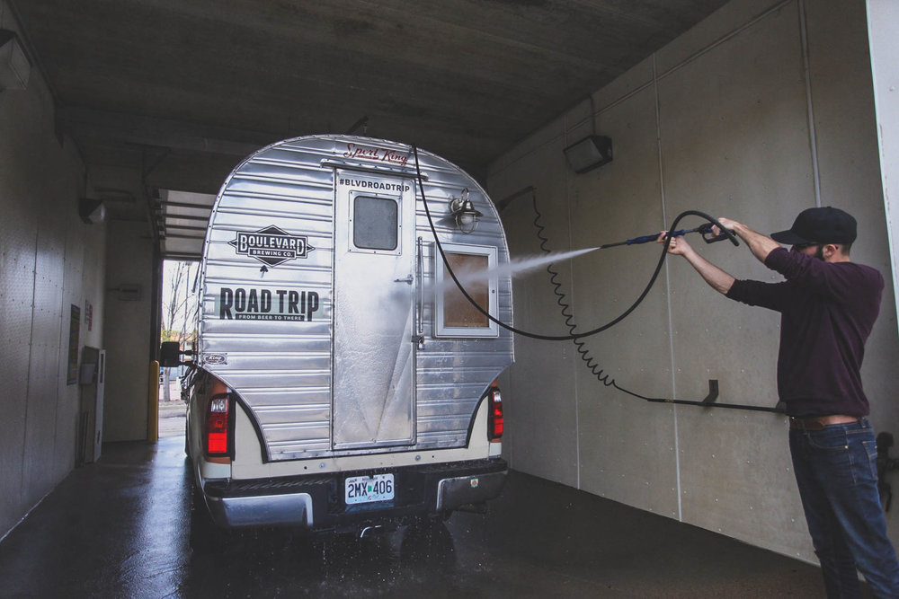 Tommy giving the BLVDroadtrip vehicle a good ol' wash down after it's journey from Los Angeles to Sioux Falls | Sioux Falls, South Dakota