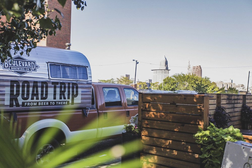 The BLVDRoadTrip truck parked with the Cleveland skyline behind it at Nano Brew | Cleveland, Ohio