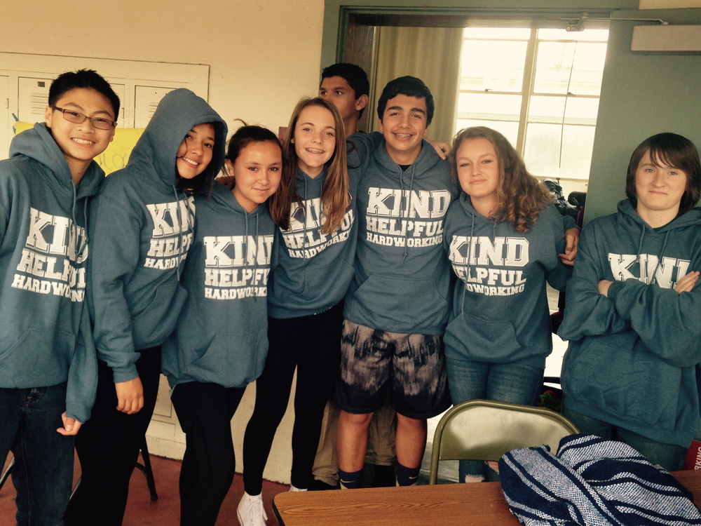 Students modeling their Kind, Helpful and Hardworking shirts to celebrate the school's Motto Weeks program