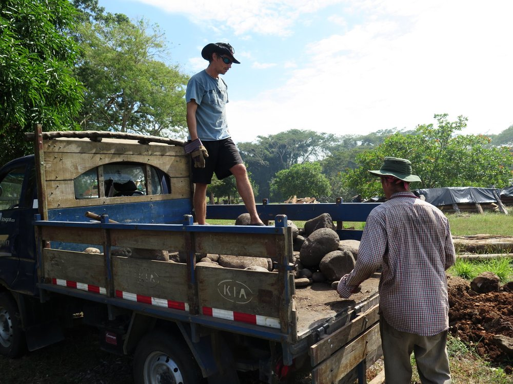 Xavier & Lynx unloading river rocks for the keel foundation.