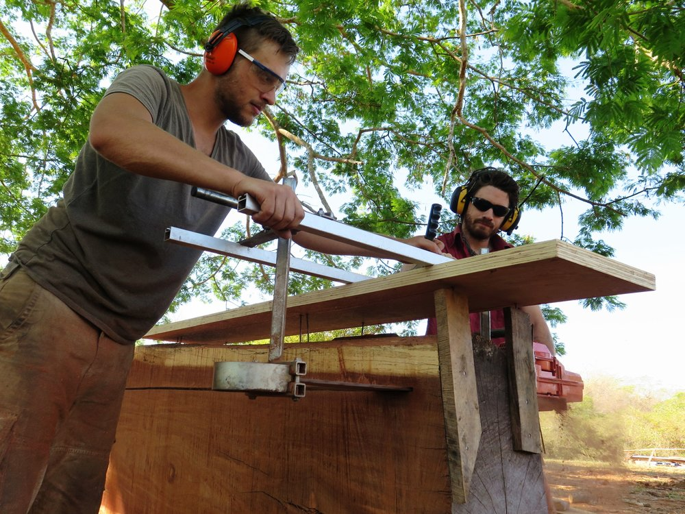Adriaan + Jack milling a keel timber of  Ceiba  on the Alaskan Chainsaw Mill.