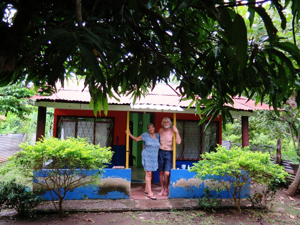 Joke & Bert outside of the front of their sweetest new little house, barely 100m from the shipyard in Punta Morales.