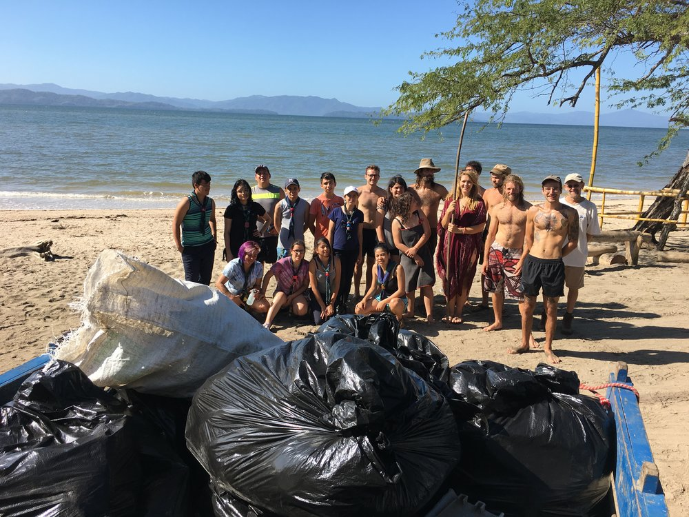 Triumphant group photo of the scouts and team  Ceiba  with bags of rubbish all ready to be taken away.