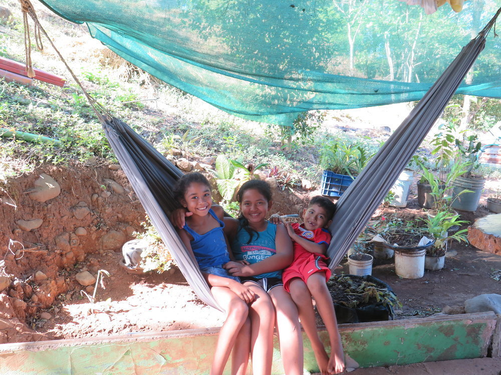 Three cuties in a hammock; Panchos's children who will soon be living in their new home.