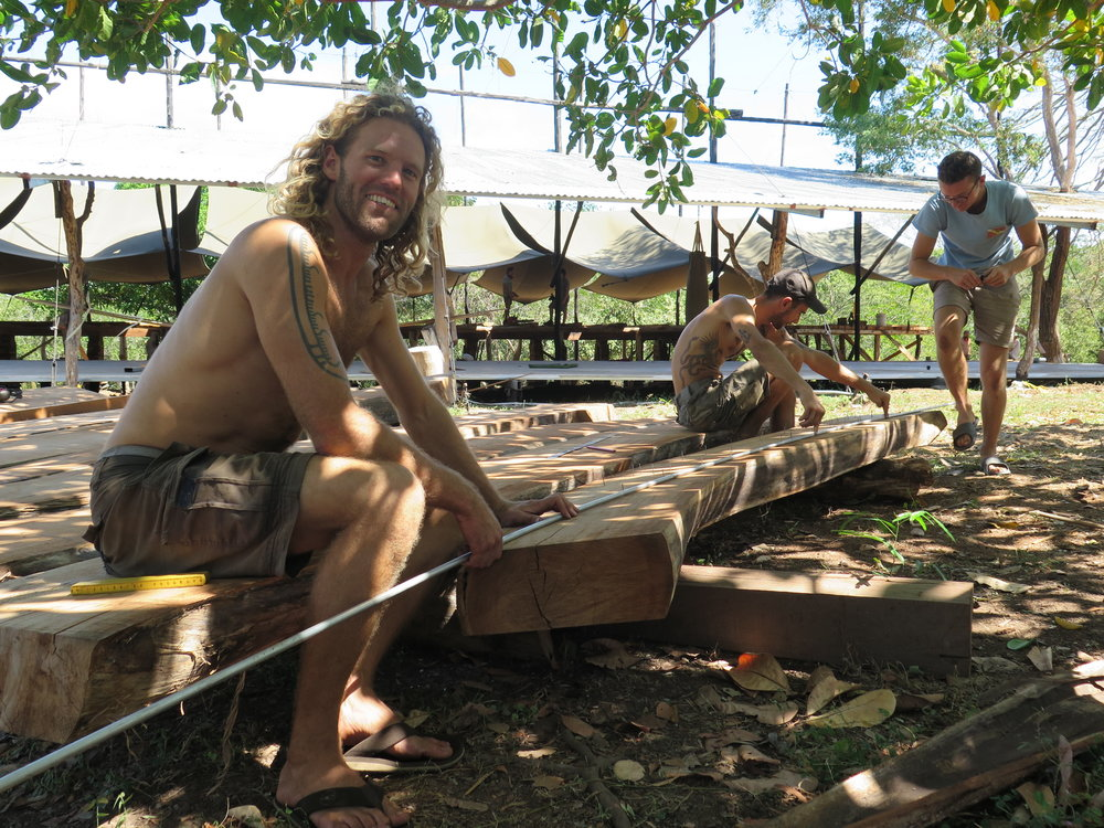 Silas grinning as he Charlie and Fred begin measuring, cutting and planing the first frames of  Ceiba !