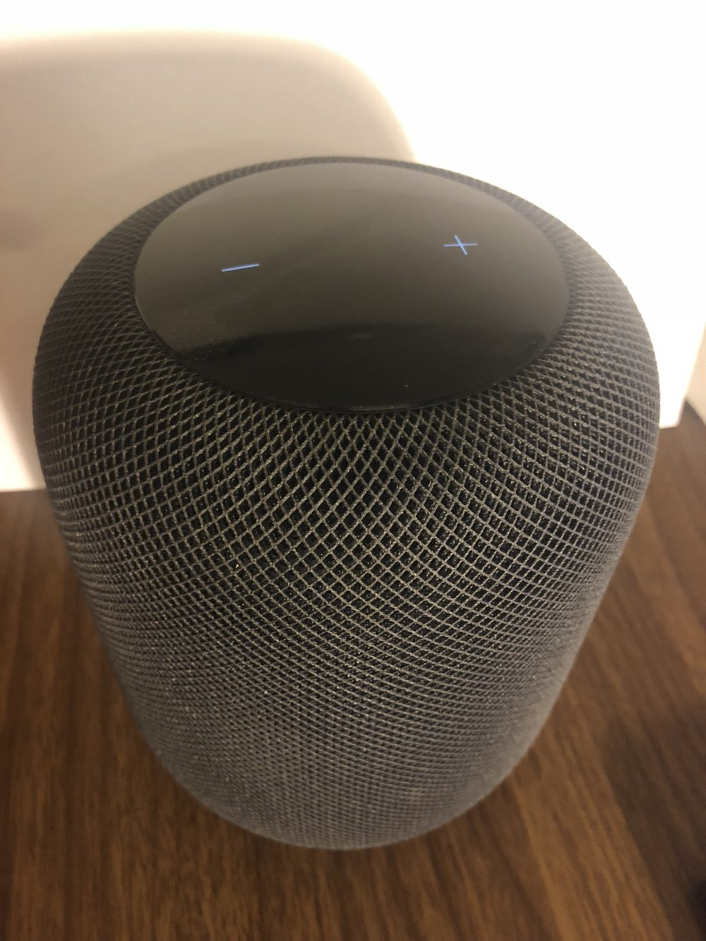 Showing the top of the HomePod when playing music