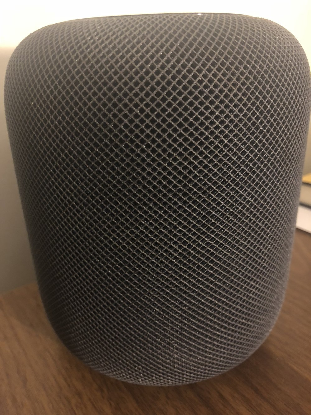 HomePod from the side, showing the side texture.