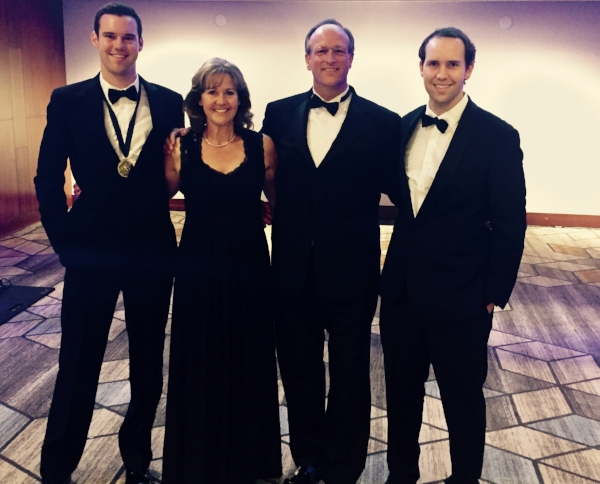 Michael Kmetz (left) with his mom, dad, and brother Joseph (right), an alumnus of the Forum Chapter