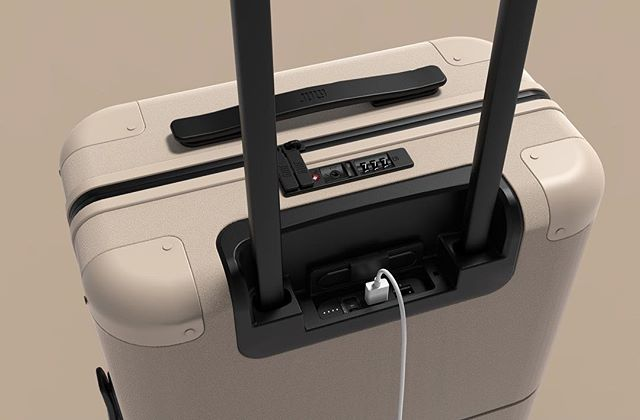 Charging ports on our July carry-ons! Perfectly integrated into the case and discreetly stored under your handle when not in use, but providing quick access to power when you need it. Get yours now, link in the bio!  #julyluggage #onedesignoffice