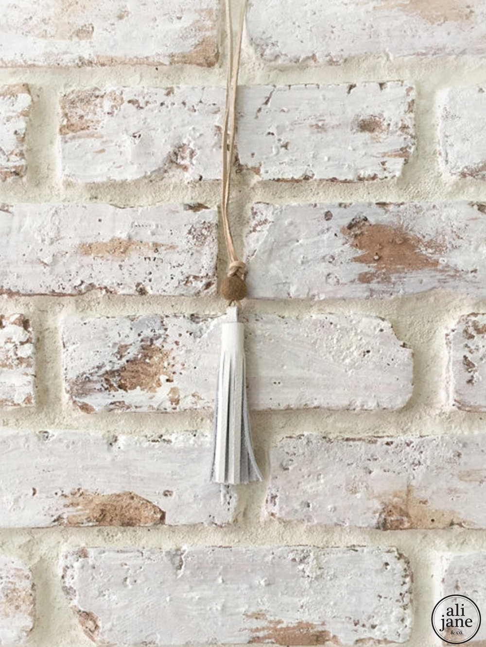 Little girls ivory tassel necklace with peppercorn wool felt pom pom