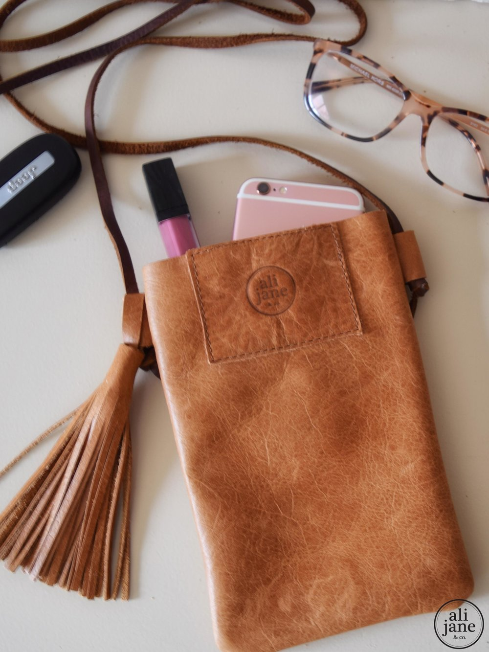 Women's tan leather cell phone purse