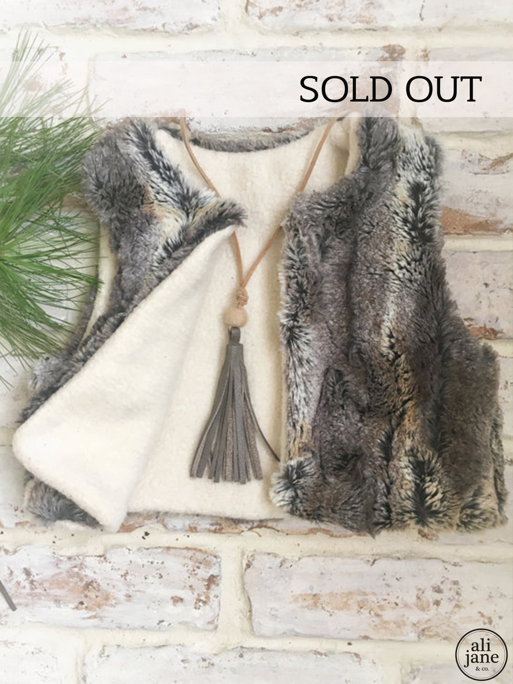 Girls reversible LUXE faux fur and organic sherpa vest