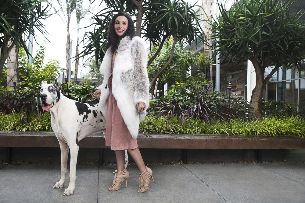 ENSEMBLE Lioness Viva italia Jumpsuit in Blush and Barbara Bui White Fox Fur Coat, available at KIN Pacific City Huntington Beach. JEWELRY Trillion Cut Morganite Pendant Accented with Diamonds on Rose Gold Chain 57ct and Oval Morganite Ring Set in Rose Gold 12ct, available at Winston's Crown Jewelers Newport Beach. SHOES Miu Miu Nude Tassel Shoes, available at On Que Style Corona del Mar.