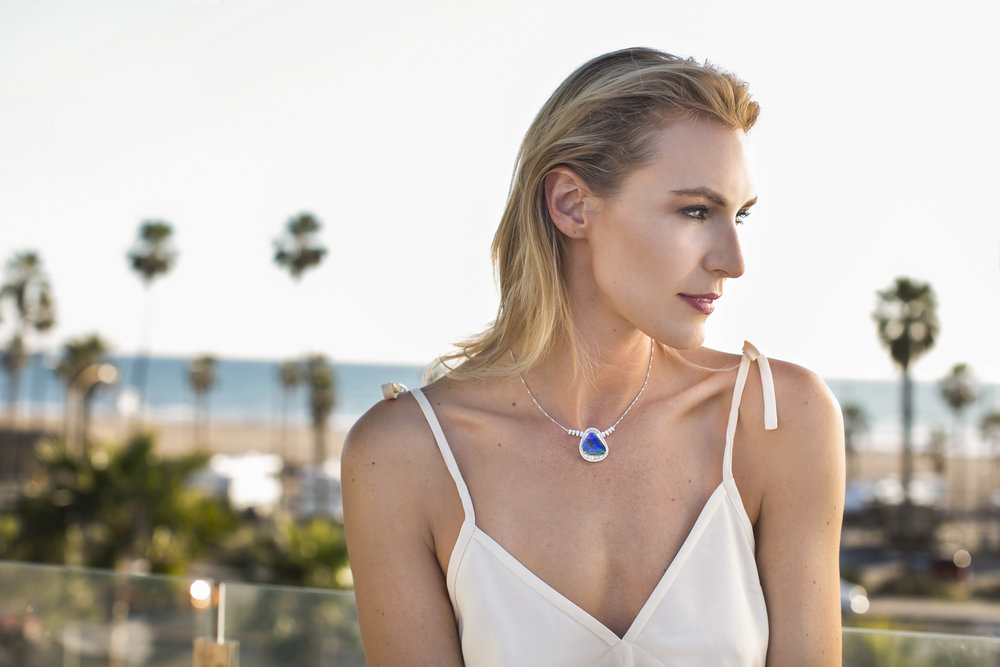 Silk tie slip dress, available at Jenni Kayne Newport Beach. Australian black boulder opal and diamond necklace, available at Winston's Crown Jewelers Newport Beach.
