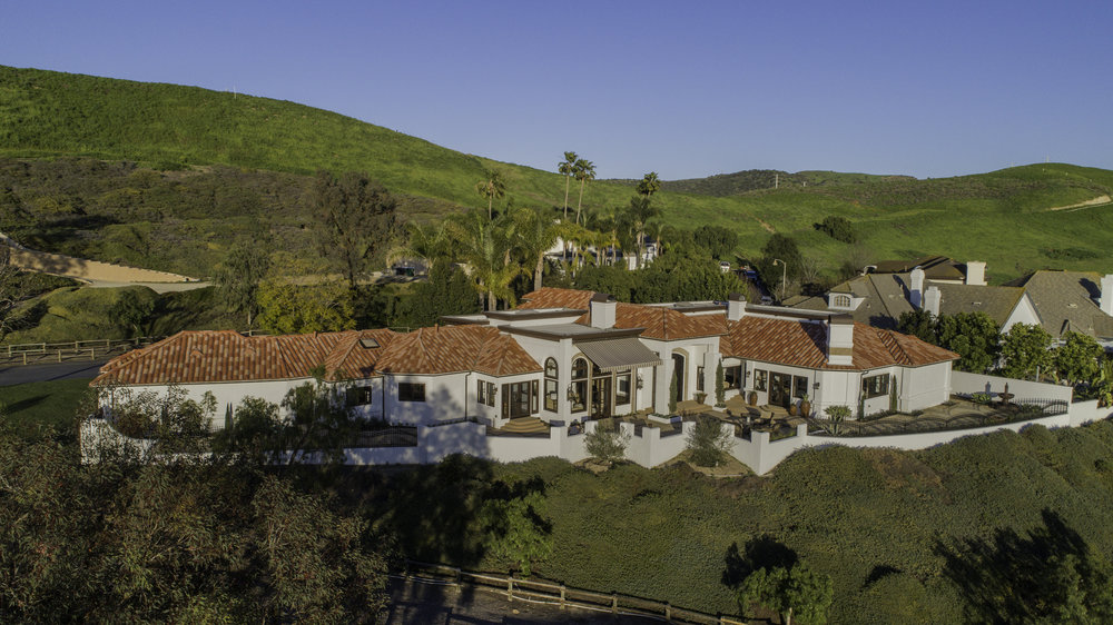 The sprawling 5,100-square-foot estate rests on a sizable half-acre lot bordered by equestrian trails and panoramic views of the rolling hills.