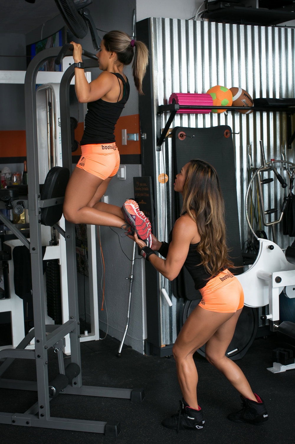 Cora Kasperski assisting her client, Andrea Keilholz, at her new Laguna Beach gym. Photo courtesy of Tony Florez