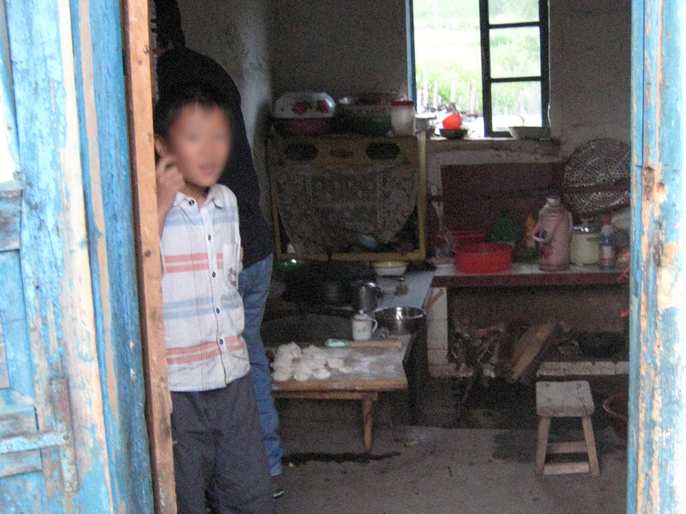 The son of a repatriated North Korean woman welcomes us into his home in rural China.
