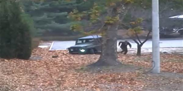 Surveillance video shows a North Korean defector running to the border with South Korea on Nov. 13. U.N. Command / via EPA