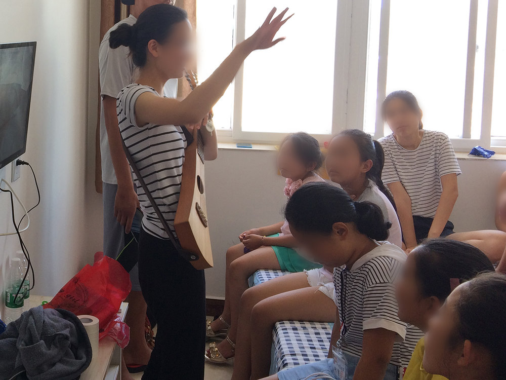Children of North Korean women learning new songs at our annual retreat.