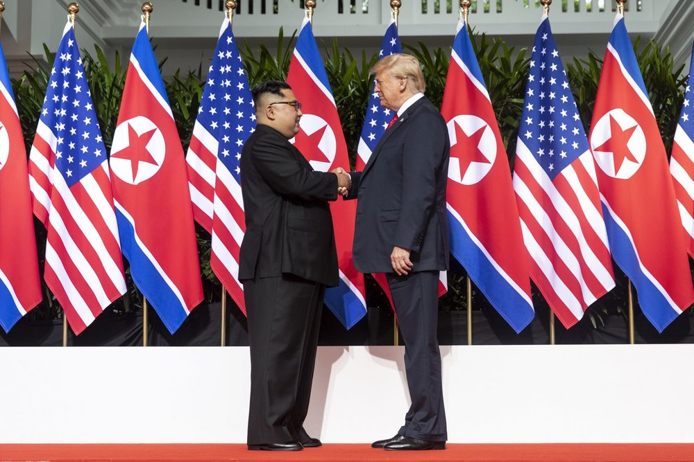 Donald Trump and Kim Jong Un shaking hands at the June summit in Singapore.