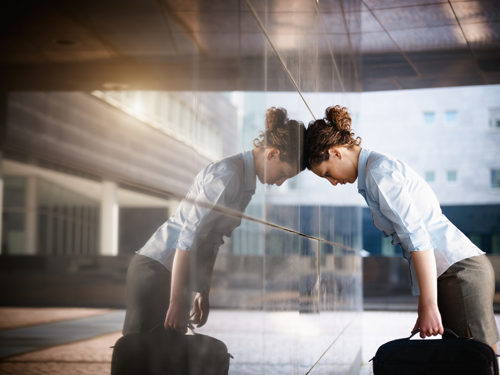 stock-photo-mid-adult-italian-woman-banging-her-head-against-a-wall-outside-office-building-horizontal-shape-52532644.jpg