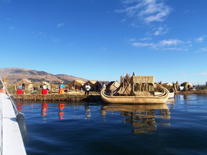 Islands of floating reed villages, complete with 'authentic' local villagers - cjG.