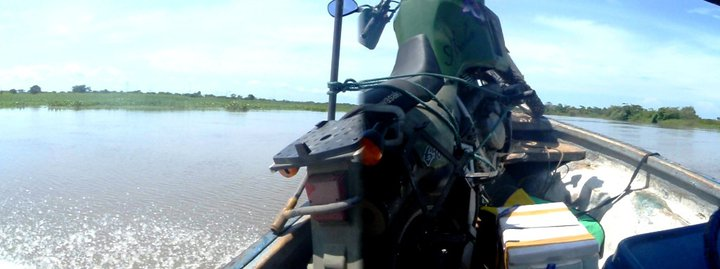 Aroha strapped to the front of some boat, getting ferried to some place, through the floodwaters, on the way to a place called Mompox, for some reason - cjG.