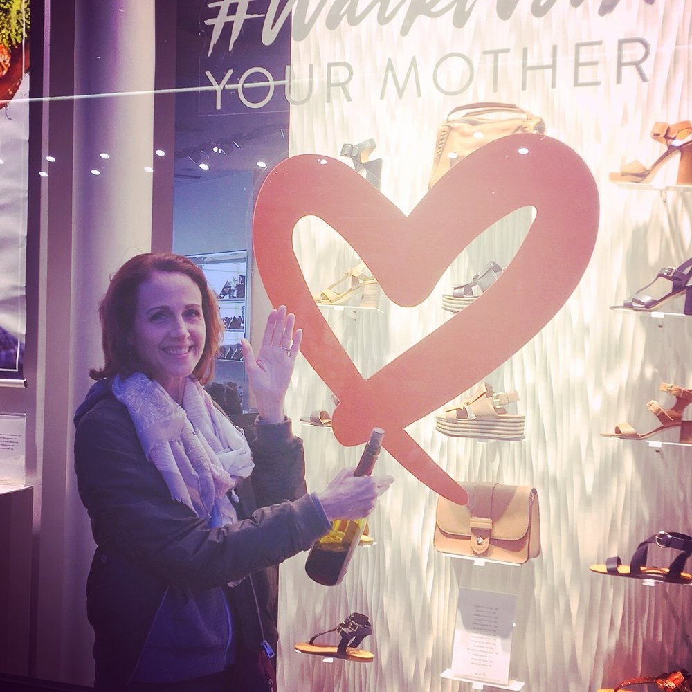 """Our story told by shop windows: """"walk with your mother"""" and """"a selfie with your beautiful mother"""""""