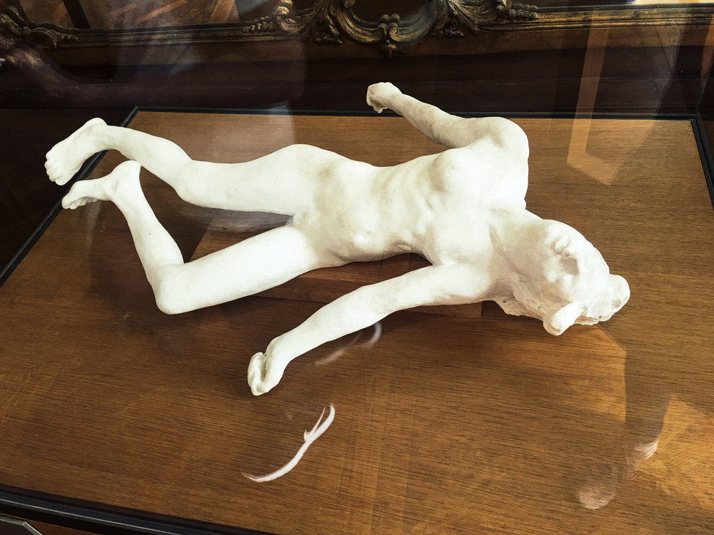 """A statue from the Rodin museum in Paris, appropriately titled """"the Martyr."""""""