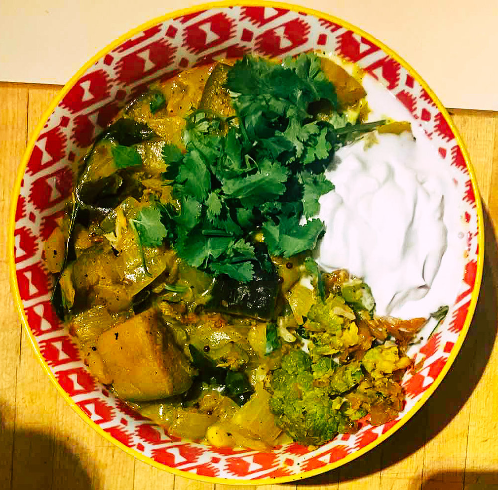 Eggplant curry, served with yogurt, cilantro and the leftover Broccoli Varai and Cauliflower Poriyal on the side. A feast fit for a queen!