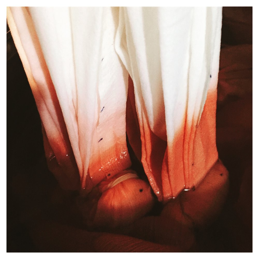 Accordion-pleated shibori dyeing in madder root