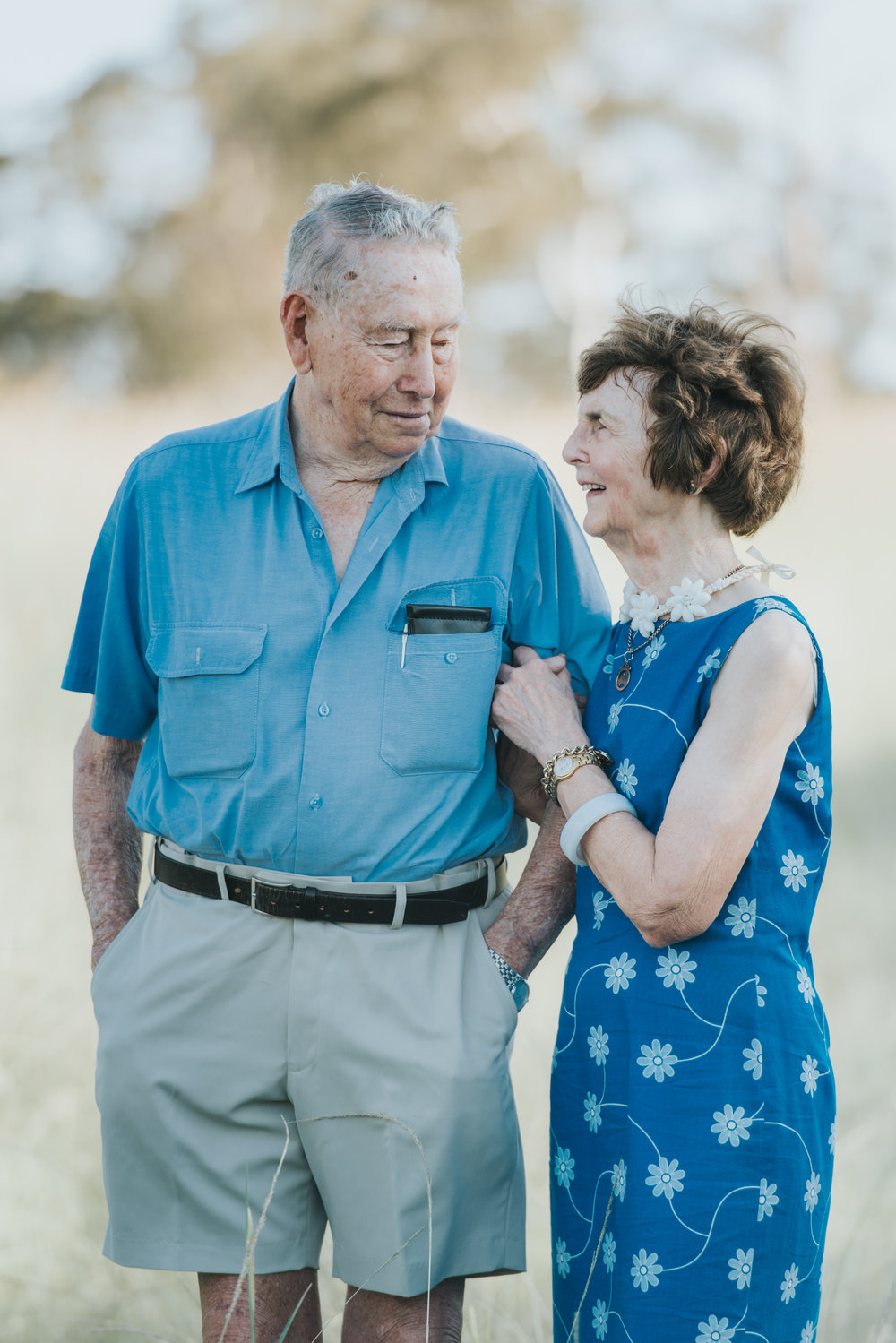 Elderly couple smiling at each other | Sirromet Winery | Lightsmith Images